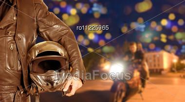 Biker Closeup At Night City Background Stock Photo