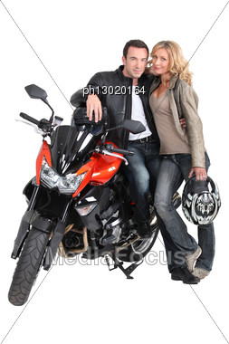 Biker Couple And Bike. Stock Photo