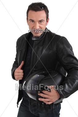 Biker Holding Helmet Stock Photo