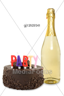 Birthday Cake And Champagne Bottle Stock Photo