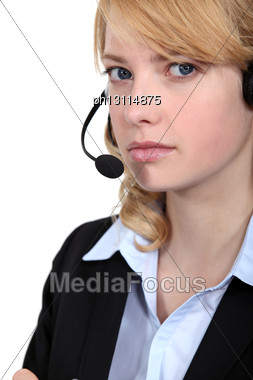 Bitter Woman Wearing A Headset Stock Photo