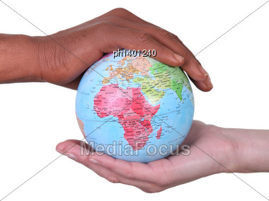 Black And White Hands Holding Globe Stock Photo