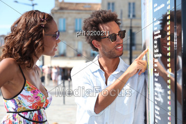 Black Couple On A Holiday Trip Stock Photo