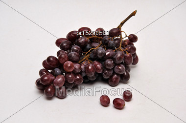Black Grapes On A Seamless Background Stock Photo