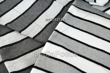 Black, Gray And White Knitwaer As A Background. Stock Photo