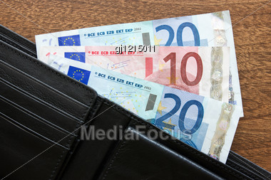 Black Leather Wallet With Euros On The Table Stock Photo