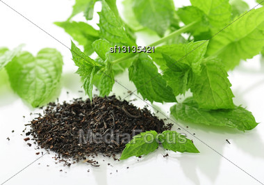 Black Loose Tea With Fresh Mint Stock Photo