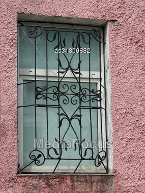 Black Metal Forged Carved Lattice At A White Window Stock Photo
