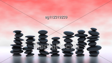 Black Pebble Stacks On Over Red Misty Background Stock Photo