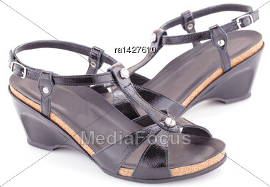 Black Shiny Sandals Isolated On White Background Stock Photo