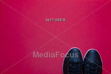Black Shoes On Red Background Stock Photo