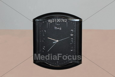 Black Watch With A Second Hand Electric Hang On The Wall Of Office Building Stock Photo