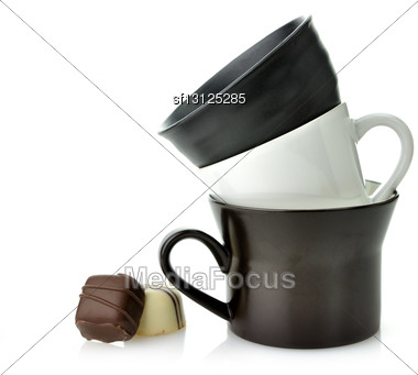 Black And White Ceramic Cups And Chocolate Candies Stock Photo