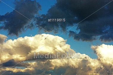 Black And White Clouds On Blue Sky Stock Photo