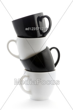 Black And White Coffee Cups Pyramid Isolated Stock Photo