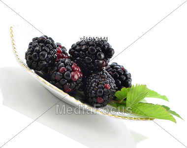 Blackberries On A Plate On White Background Stock Photo