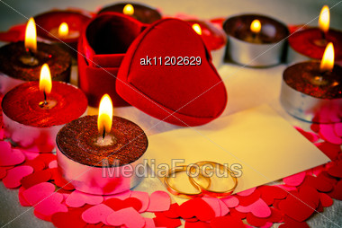 Blank Card And Two Rings And Candles. Shallow Depth Of Field. Stock Photo