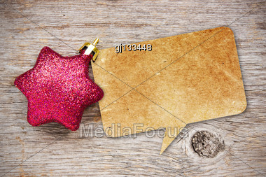 Blank Recycled Paper Speech Bubble With Christmas Bauble On Wood Background Stock Photo