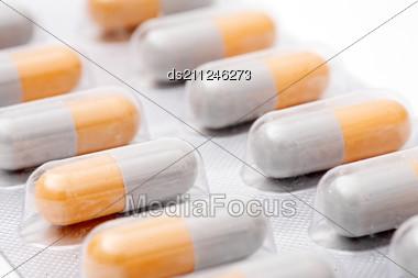 Blister Pack Of White-orange Pills Stock Photo