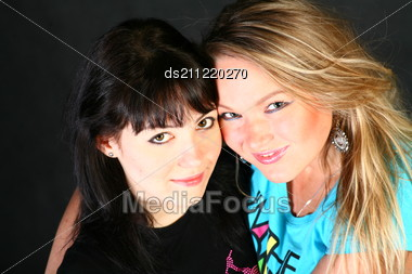 Blond And Brunette Sensual Women Studio Shot Stock Photo