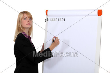 Blond Businesswoman About To Write On White-board Stock Photo