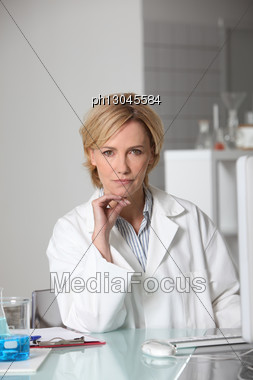 Blond Scientist In Laboratory Stock Photo