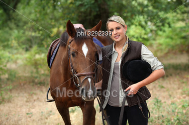 Blond Teenager With Horse Stock Photo