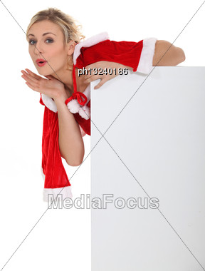 Blond Woman Dressed In Christmas Outfit Stock Photo