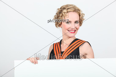Blond Woman Holding Blank Message Board Stock Photo