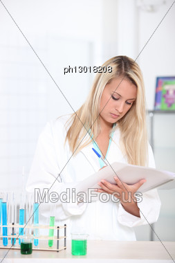 Blond Woman In Science Laboratory Stock Photo