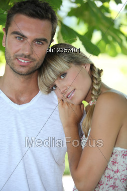 Blond Woman Leaning On Man's Shoulder Stock Photo
