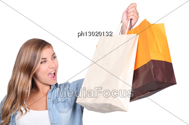 Blond Woman Stood Holding Shopping Bags Stock Photo