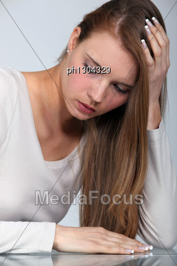 Blond Woman With A Headache Stock Photo