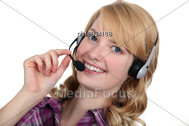 Blond Woman With A Headset On. Stock Photo