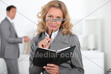 Blond Woman With Book In Hand Stock Photo