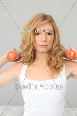 Blonde Girl With Orange Weights Stock Photo