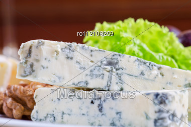 Blue Cheese With Lettuce, Grapes And Nuts Closeup Stock Photo