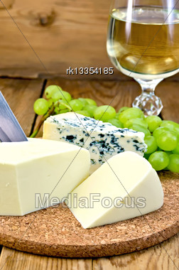Blue Cheese, Suluguni, Grapes, Wine In Wineglass, Knife On Background Wooden Board Stock Photo
