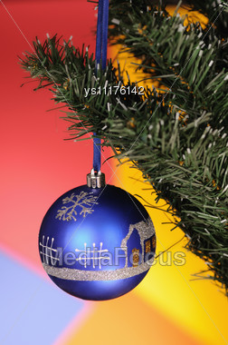 Blue Christmas-tree Decoration On Multicoloured Background Stock Photo