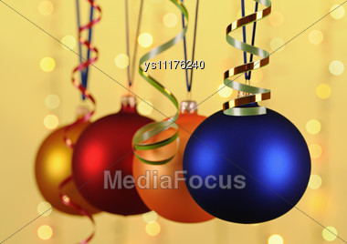 Free Stock Photo: Blue Christmas-tree Decoration On Yellow Background