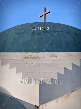 Blue Church Dome With Cross At The Top Against Clear Blue Sky At Sunny Summer Day Stock Photo