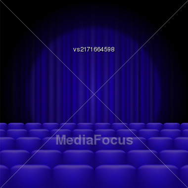Blue Curtains With Spotlight And Seats. Classic Cinema With Blue Chairs Stock Photo