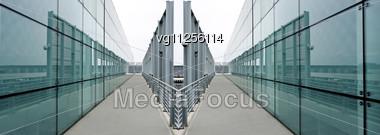 Blue Glass Panels Reflecting Light And Surveillance Camera Stock Photo