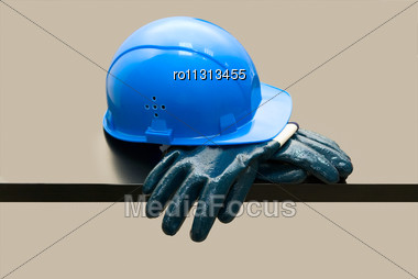 Blue Hardhat And Leather Gloves Stock Photo