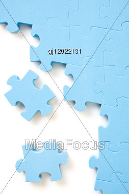 Blue Jigsaw Puzzle Pieces Stock Photo
