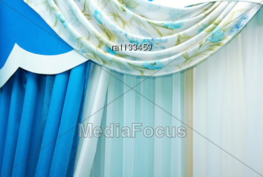 Blue Luxurious Curtains As A Background. Stock Photo