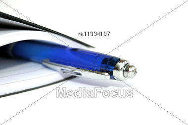 Blue Pen In The Black Note-book. Stock Photo