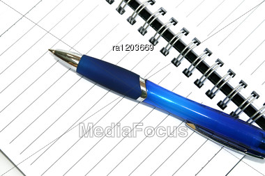 Blue Pen On The Spiral Bound Note-book Paper. Stock Photo