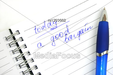 Blue Pen On The Spiral Bound Note Book. Stock Photo