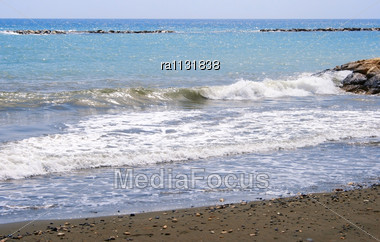 Blue Sea Beach Snd Rock Stock Photo